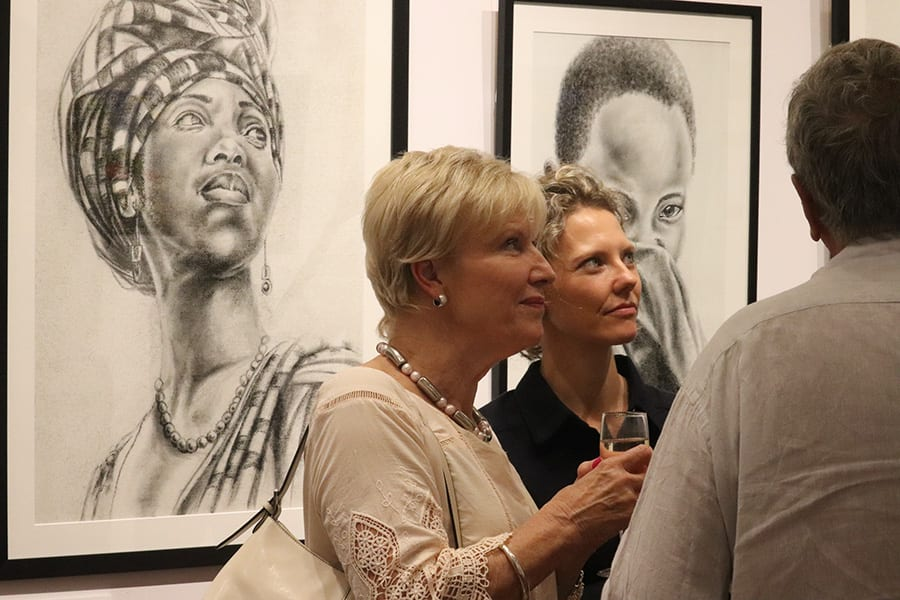 Victoria Lewis with guests at SANAA Exhibition 2019 opening