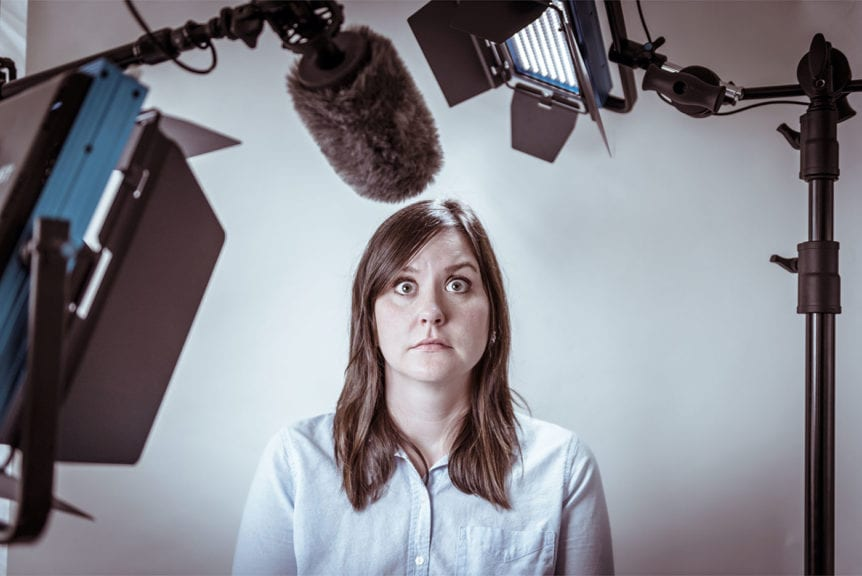 Woman looking scared in front of camera