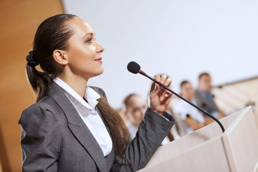 Woman presenting to an audience