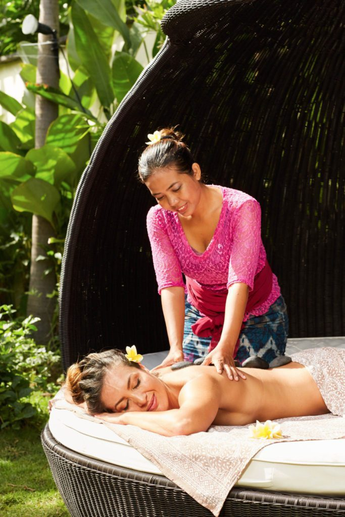 Woman enjoying a massage - Bliss is so much more than a Bali spa vacation or Bali spa retreat, experience pure bliss with unlimited spa treatments with our personally trained staff and their amazing healing hands.