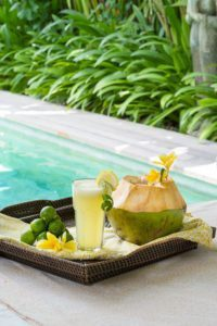 Beautifully presented food and drinks by the pool at Bliss Bali Yoga and Spa Retreat - where food s unlimited