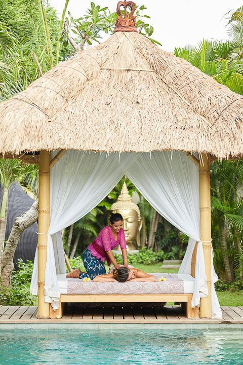 A guest being pampered  in beautiful outdoor setting - unlimited spa treatments at our Bali and spa retreat