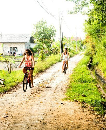 Women riding bicycles in Bali