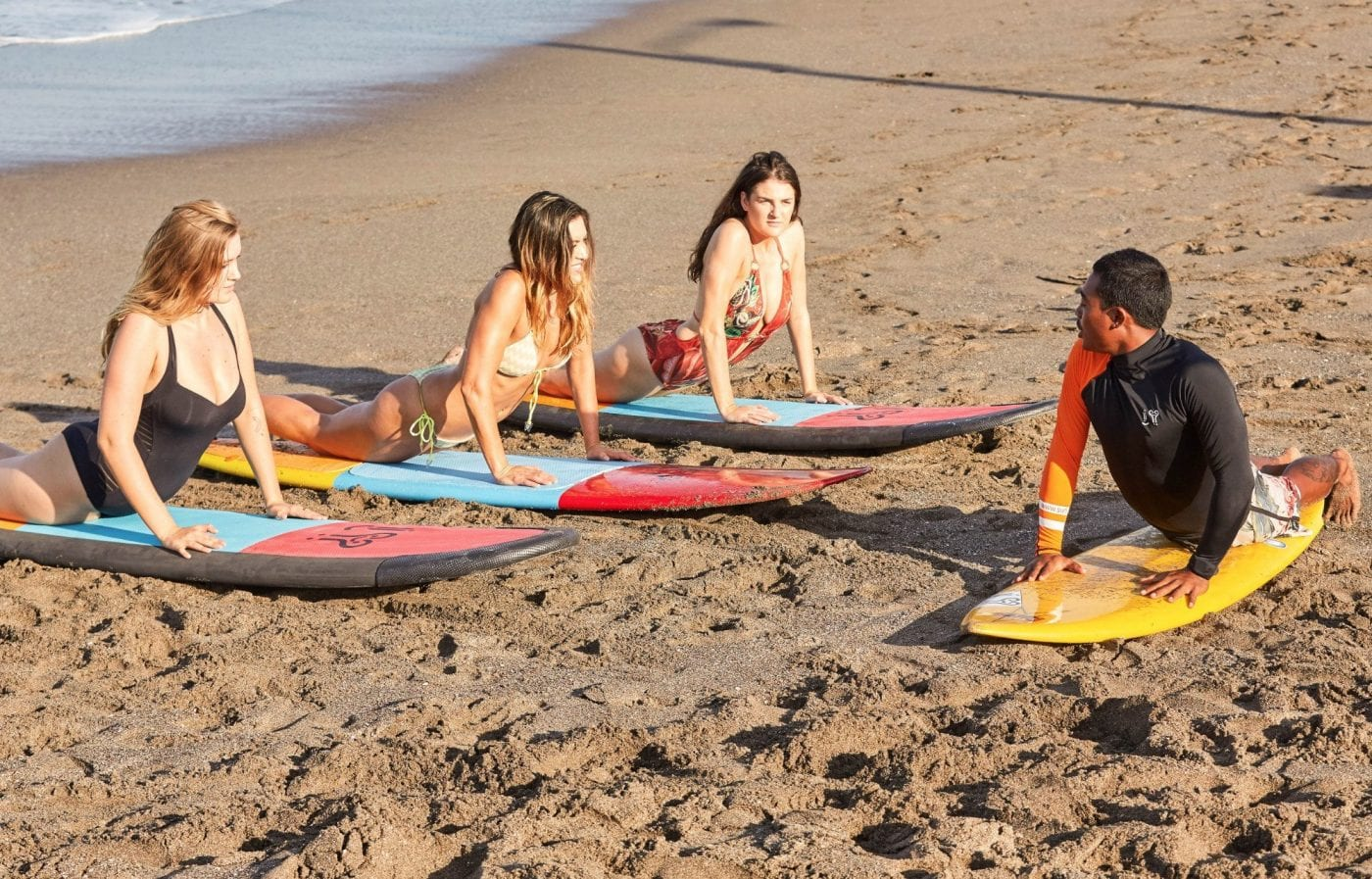 Women receiving one on one surf lessons included in our Retreat Surf Package in Bali