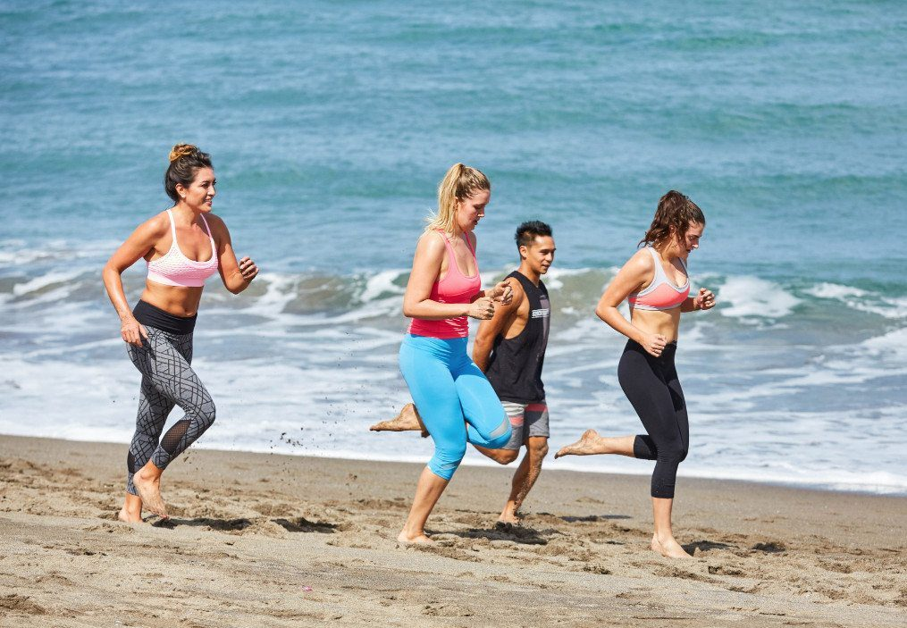 Women group training with a personal trainer on beautiful Bali beach on the Bliss Active Retreat Package