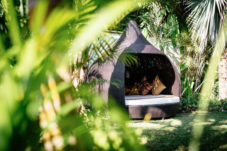 Bliss Sanctuary for Women Seminyak Villa gardens with day bed to relax