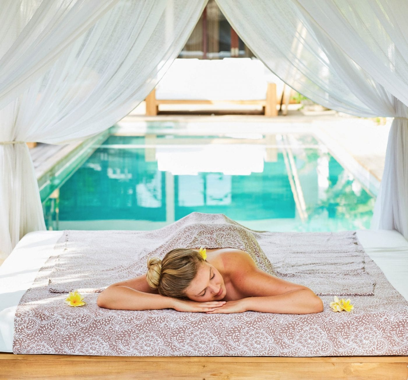 Unlimited massages by the pool at our Bali Retreat