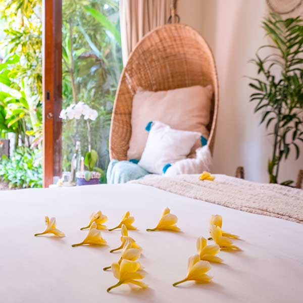 Beautiful bed setting with hanging chair in the background in Bali retreat bedroom, Bliss Retreat Room, Bliss Sanctuary For Women, Canggu