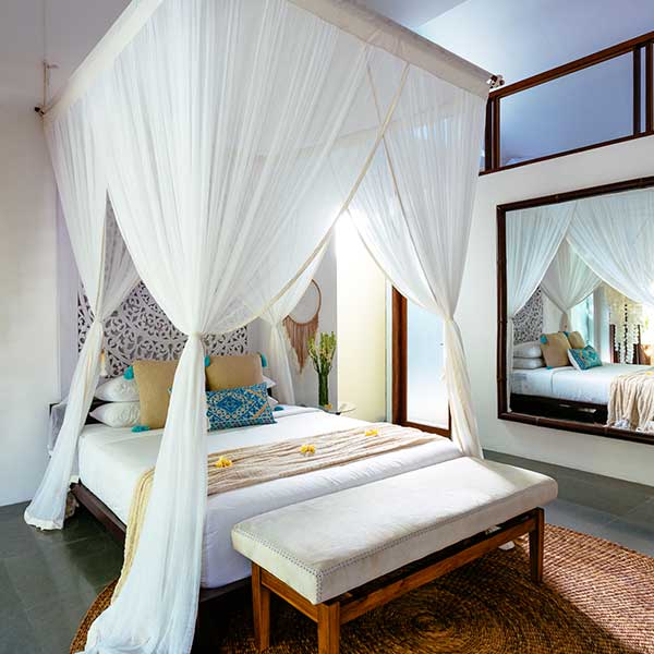 Beautifully styled King bed with mosquito net in luxury bedroom in Bali retreat, King Deluxe Pool Room with Loft, Bliss Sanctuary For Women, Seminyak