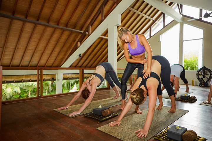Women in yoga class in a gorgeous yoga shala at Bliss wellbeing retreat in Bali - with us yoga classes are unlimited