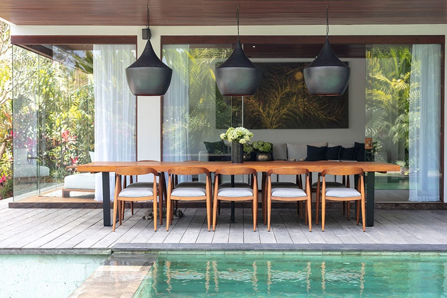 Outdoor dining by pool Ubud Bali