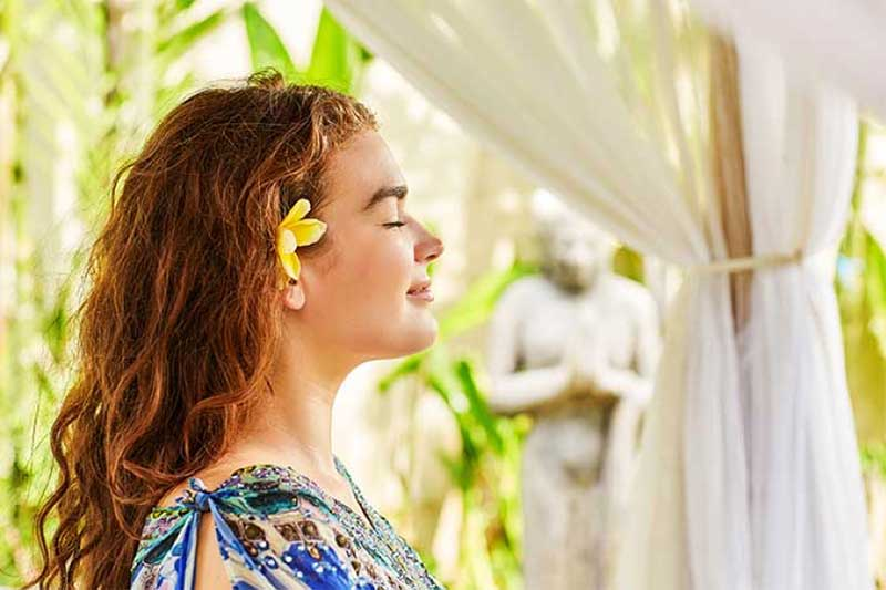 Girl relaxing with flower in her hair at Bliss Bali retreat