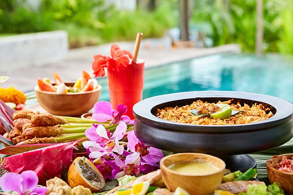Delicious healthy food by the pool at Bliss Bali retreat
