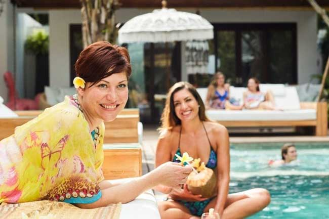 Guests by the pool at Bliss Bali retreat