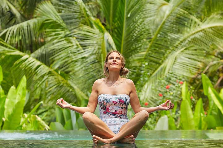 Guest meditating by the beautiful pool at Bliss Retreat Bali
